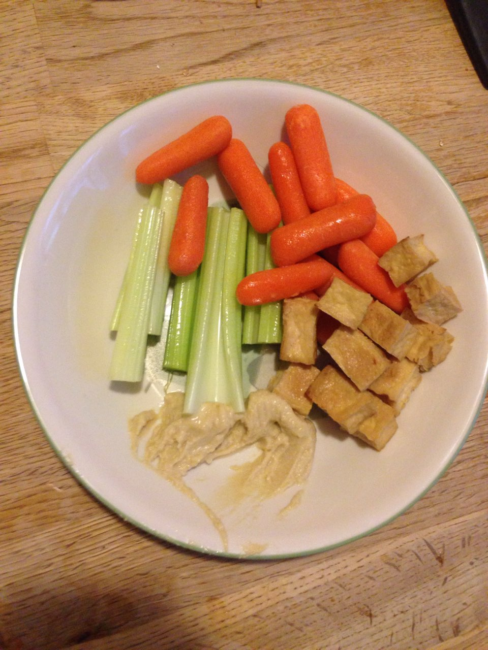 Yummy AND filling snack for less than 160 calories! Celery <15 cals,  carrots ~25 cals, 2 Tbsp Hummus 34 cals, and 1 serving of cubed tofu 80  cals.